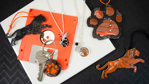 RIT tigers handmade gifts made from recycled circuit boards. I've also created tiger paw keychains and ornaments in orange and black for school spirit