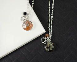 handmade recycled circuit board necklace with tiger paw charm for rit