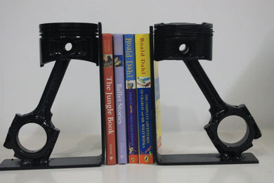 Piston book holder