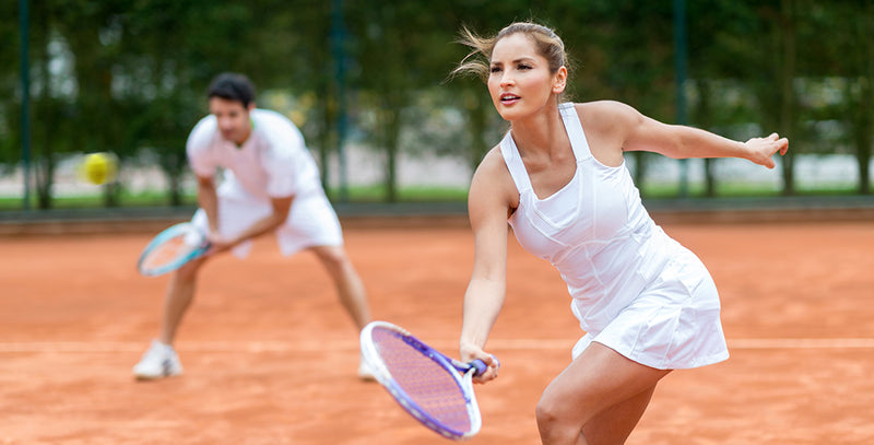 two couple playing tennis