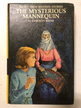 The Mysterious Mannequin - Slick Cat Books