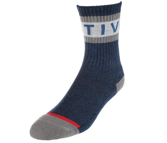 "Youth Active Foam Sock in heather blue features an athletic ribbed fit with a contrasting grey heel and toe, with grey stripes and blue ""Active"" writing across the top crew."