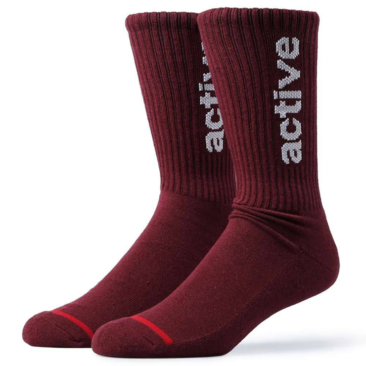 "Active Ride Shop Men's Crew Socks in Burgundy with white ""active"" writing up the side."