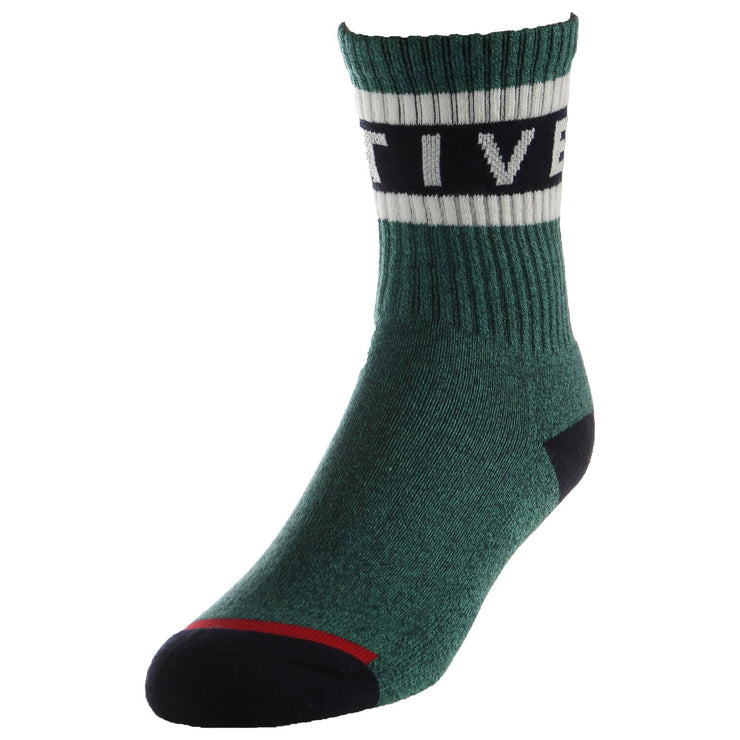"Youth Active Foam Sock in heather green features an athletic ribbed fit with a contrasting navy blue heel and toe, with a stripe and white ""Active"" writing across the top crew."