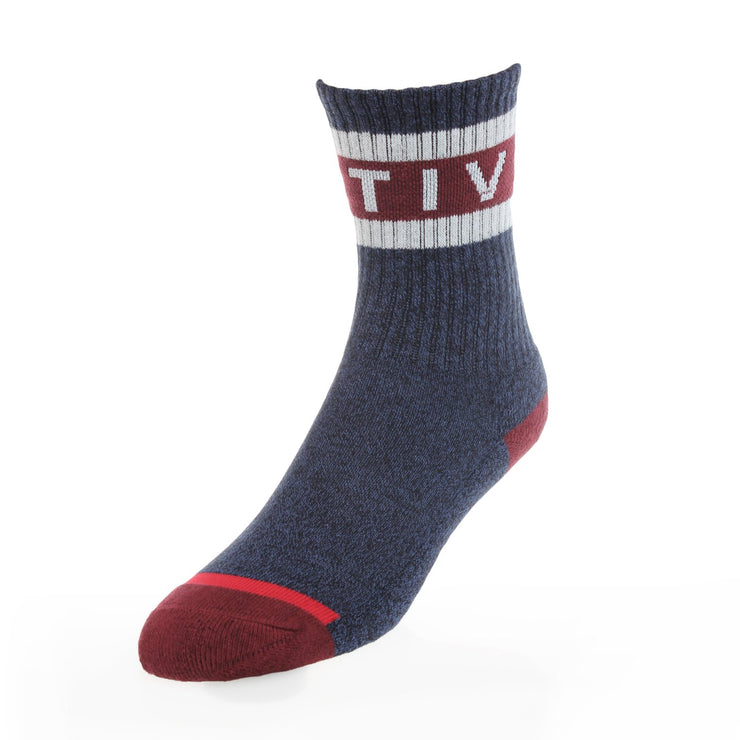 "Youth Active Foam Sock in heather blue features an athletic ribbed fit with a contrasting maroon heel and toe, with white stripes and white ""Active"" writing across the top crew."