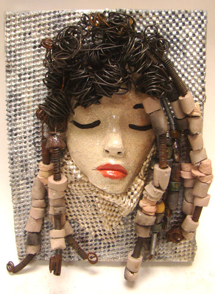 "I started making mask after seeing an authentic African Mask collection at the Smithsonian Museum of African Art. I was in total awe. Angel was inspired by my visit there. Angel is mounted on a 9""x 12"" painted canvas. I spent about 4 hours or more just  fixing Angel's hair and attaching beads! She has over 40 feet of 16 gauge wire for hair and over 30 raku beads. Angel has a white crackle face with ruby red lips. She is ready to be hung! Free Shipping!"