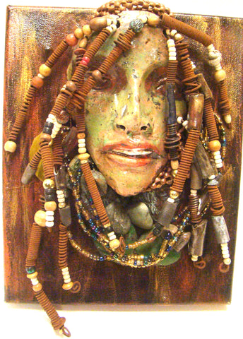 "April is mounted on a 8""x 10"" painted canvas. I spent about 4 hours or more just  fixing  April's hair and attaching her beads! She has over 40 feet of 16 gauge wire for hair and over 50 raku beads. April has a yellow green crackle face with green eyes, and ruby red lips. She is ready to be hung!  Free Shipping!"