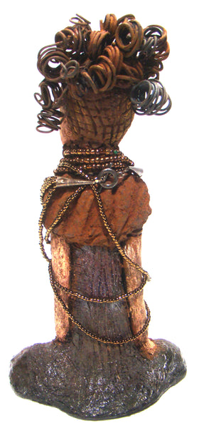 "Cardi stands 11"" x 5.5"" x 3"" and weighs 1.14 lbs. She has an awesome two tone honey beige complexion. Cardi wears a dark metallic copper dress with a chocolate ruffle scarf.  She wears a multitude of amber colored hand strung beads. I do believe Cardi would like it if you gave her a space in your home!"