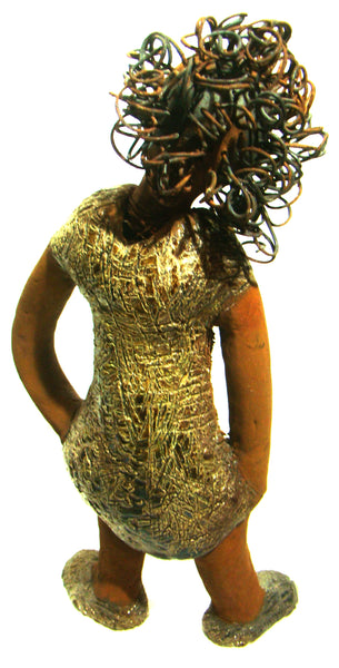 "Connie stands  16"" x 7"" x 3"" and weighs 3.13 lbs Connie has honey brown complexion with 16 gauge wire hair. She wears an iridescence alligator green dress and shoes."