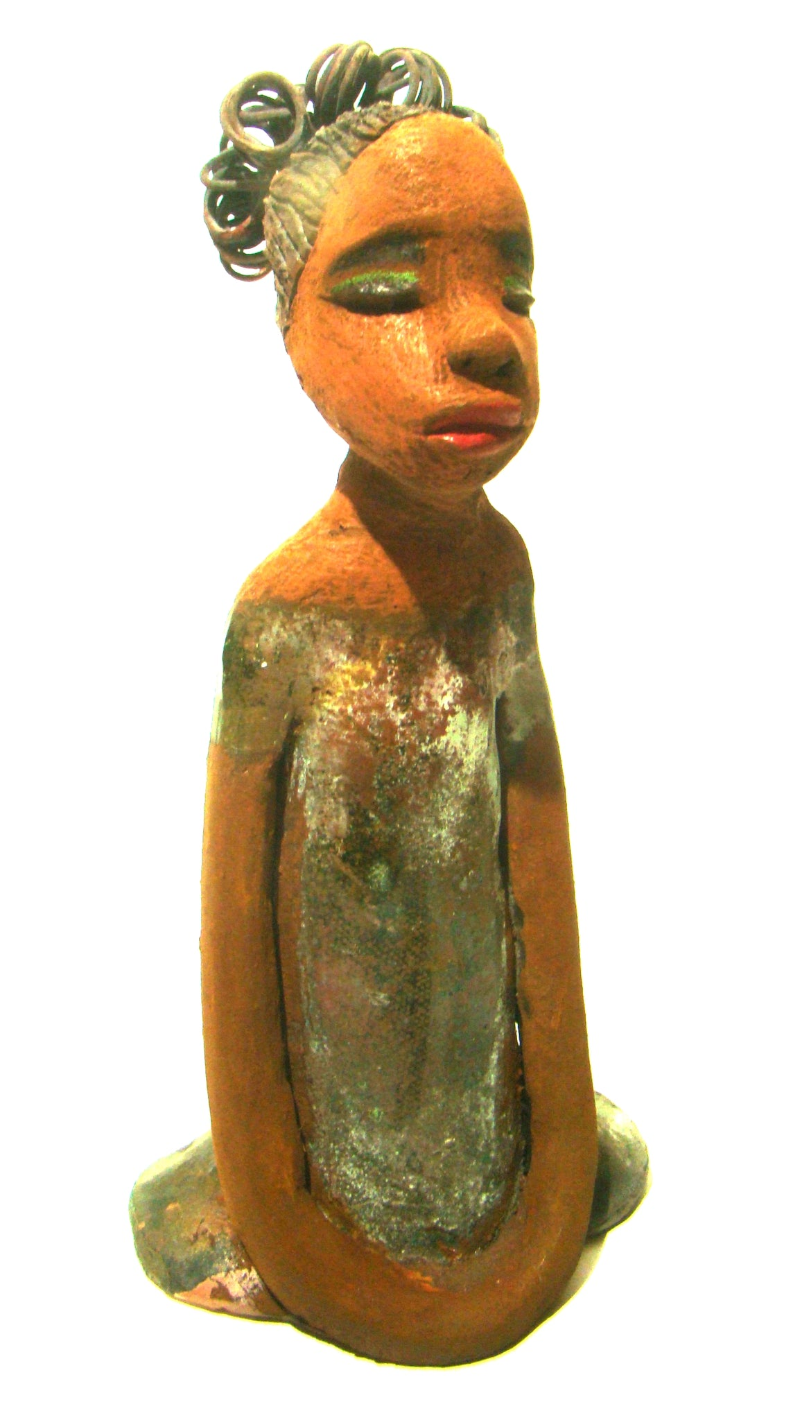 "Erica  stands 10"" x 5"" x 4"" and weighs 1.10 lbs.     Erica has an awesome honey complexion.     Her hair is made of wire and etched clay.     She has a combination of glossy and matte green glazes on her dress.     Erica long loving arms rest gracefully at her side."