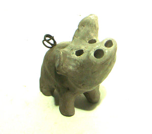 "This Little Piggy stands 4"" x 2"" x 3"" and weighs 6.7 ozs.     It has a smokey grey color with a wire curly tail.     Cute!"