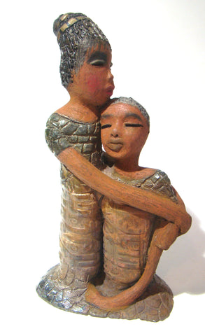 "Girl Talk with my Mom stands 13' x 7"" x 4"" and weighs 14.lbs. They were raku fired etched metallic copper dresses. Their hair is made of clay and raised into an etched bun. They have lovely honey brown complexions and long loving arms. Girl Talk with my Mom would remind one of those special moments in tim"