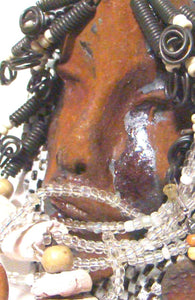 "Paul is a raku fired mask mounted on painted  4""x 6""canvas."
