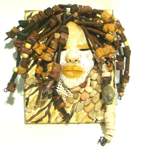 Destiny is a canvas mounted raku fired mask.