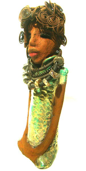 "Martina stands 13"" x 5"" x 4"" and weighs 3.15 lb. She wears a large beaded coiled collared necklace. Martina wears a metallic green gold textured dress. Martina has an awesome honey brown complexion that compliments her subdued look. She has those familiar long loving arms! Martina is looking for a new home. She is a conversation piece. Free Shipping!"