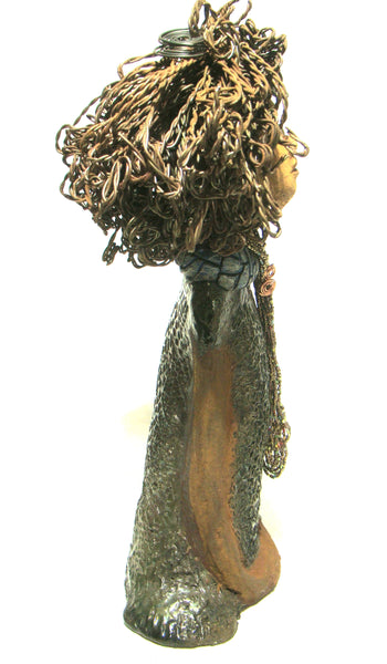 "Emily stands 17"" x 8"" x 5"" and weighs 7 lbs. She has black and brown curly twisted 16 gauge wire hair. Emily has a lovely metallic textured green dress with a long string of multi colored beads."