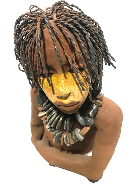 "Ethan stands 14"" x 9"" x 10"" and weighs 10.06 lbs.     He has an awesome two tone honey brown complexion.     His shoulder length hair is twisted 16 gauge wire.     Ethan wears two detachable raku fired beaded necklaces I am sure he wouldn't mind you wearing from time to time!"