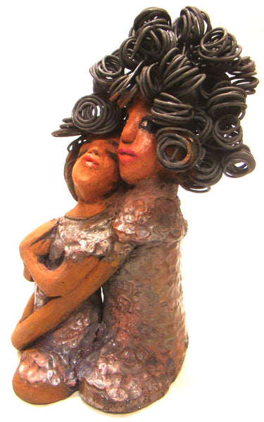 "I Love You More stands 8.5 "" x 4.5"" x 4"".5"" and weighs 2.10 lbs. They have lovely honey brown complexions. Combined, I Love You More has over 25 feet of curly wire hair. They have glossy metallic copper dresses. They have long loving arms. One  is embracing the other. I Love You More! will  help illustrate the love that is in your home! Free Shipping!"