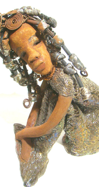 Miami is lovely dark skin mermaid with braided beaded wire hair.