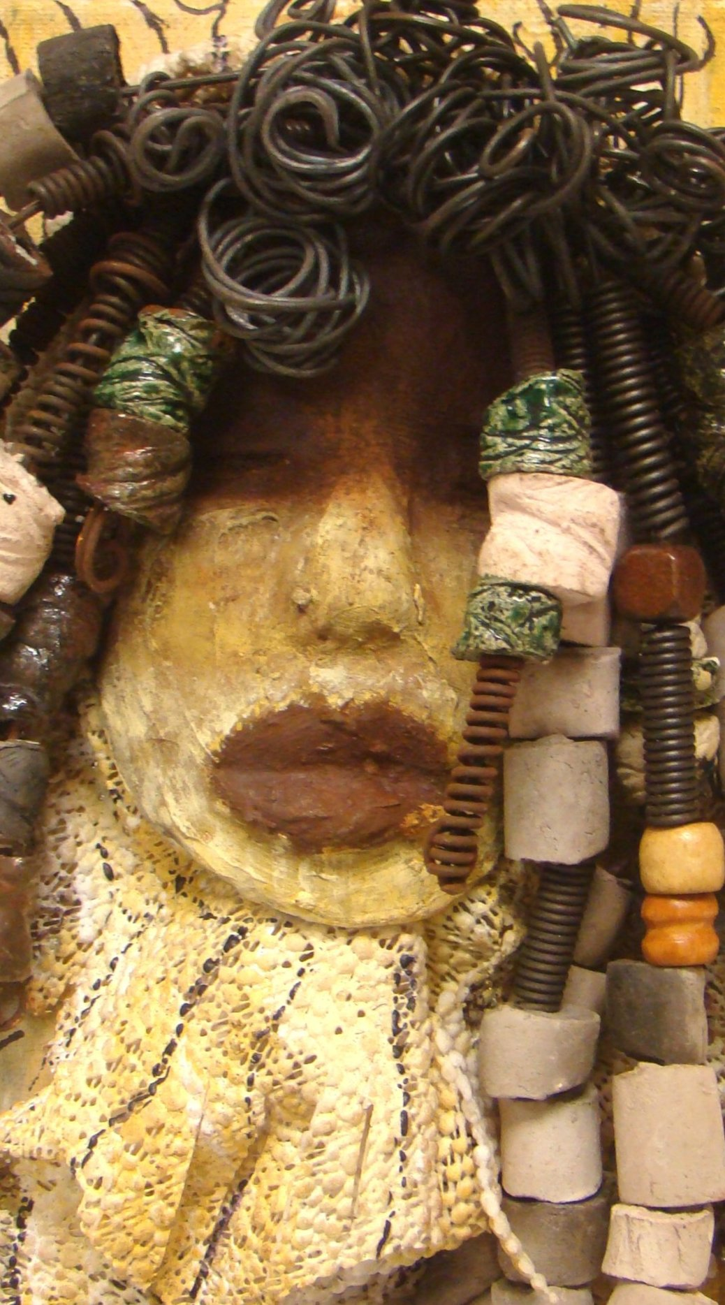 "I started making mask after seeing an authentic African Mask collection at the Smithsonian Museum of African Art. I was in total awe. Millie was inspired by my visit there. Millie is mounted on a 9""x 12"" painted canvas. I spent about 4 hours or more just  fixing Millie's hair and attaching her beads!      Millie has over 40 feet of 16 gauge wire for hair and over 50 raku beads.     Millie has a two tone  white chocolate crackle face with rust chocolate lips.     She is ready to be hung!   Free Shipping!"