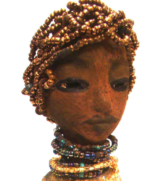 "Morgan stands 11.5"" x 5"" x 3"" and weighs 1.11 lbs. Morgan has a lovely honey brown complexion with gold beaded hair. She has a multicolored beaded necklace that compliments her metallic blue and gold dress. Morgan has her long loving arms at her side waiting with anticipation. She anticipates going to a great home! Free Shipping!"