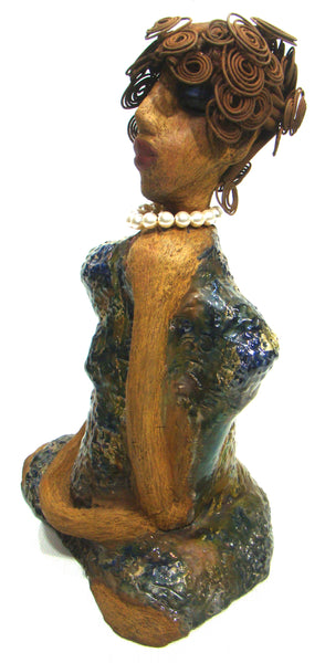 "Ms. Mee stands 15"" x 10"" x 7"" and weighs 8 lbs. She has a lovely honey brown complexion. She has over 25 feet of and spirals coils of wire hair. Ms. Mee wears a blueish copper metallic dress with  Swarovski Crystal Creamrose Pearls. She holds one of her long loving arms up to her neck. Ms. Mee appears to be somewhat of an aristocrat. She really needs a place of her own that demands attention in your home. Free Shipping!"