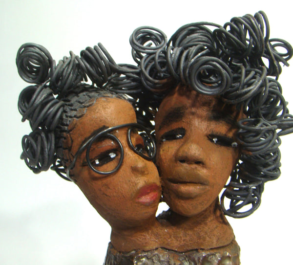 "My BFF stands 13"" x 8"" x 4"" and weighs 4.13 lbs.     Both girls have lovely honey brown complexions.     Their dresses are textured and have copper metallic glazes.     The long loving arms of My BFF embrace one another with love.     My BFF has over 25 feet of curly 16 gauge wire hair.     My BFF represents the close bond and friendship that has developed between all women of every race, ethnicity, and color.     My BFF will make an excellent gift to your BFF!     Free Shipping!"