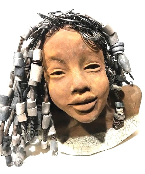 "Peggy stands 10"" x 11"" 10"".     She has  over 120 hand made raku beads!     Peggy has spiral and coiled hair that is  over 40 feet in length.     She has a lovely honey brown rust complexion.     Her dress top is a white crackled glaze.     Peggy will bring joy to your surroundings."