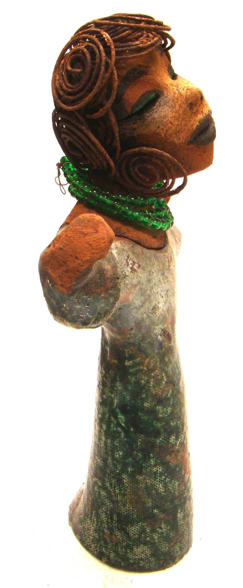 "Praise Him!      Praise Him stands 11"" x 6.5"" x 3"" and weighs 1 .11 lbs.     She has a lovely cocoa complexion.     Praise Him stands with outstretched arms.     She wears a metallic green green robe with a stand of mini green beads.     She has a over 15 feet of spiral rust wire hair.     Praise Him speaks to everyone.     Give this one of a kind a prominent place in your home.     Free Shipping!"