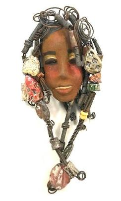 Reeda - Raku fired mask with over 20 handmade beads and  30 feet of 16 gauge  wire.