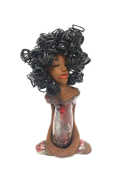 "Meet Sandra!      Sandra stands 9"" x 4.5"" x 2.5"" and weighs 1.11 lbs.     Sandra has a lot of wire hair. There is over 20 feet of curls!     She has a lovely honey brown complexion.     Her dress is a metallic red silvery glaze.     Sandra long loving arms rest at her side.     She has a look of......  Sandra will sit well in your home Free Shipping!"