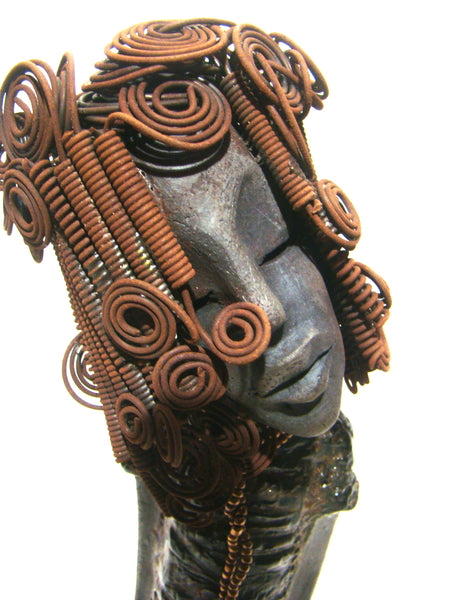 "Shelia  stands proudly at 12"" x 6"" x 5"".     She weighs 3.9 lbs.     Shelia wears a raku fired textured copper dress with bronzed colored beads around her neck.     She has over 30 feet of 16 gauge wire locs that coils and spirals into a fancy ""herdew"" hairstyle.     Her long loving arms with a slight tilt of head makes her ""sassy"".      Free Shipping!"