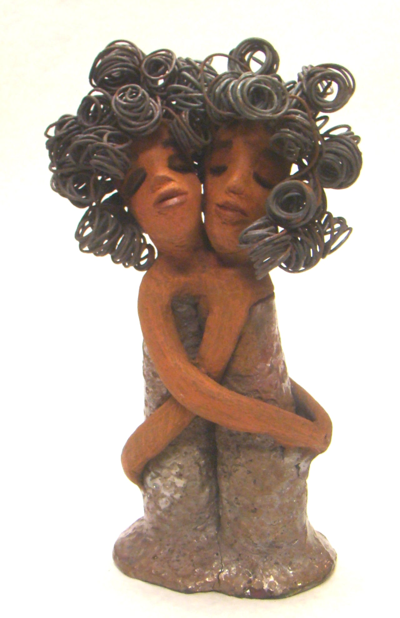 "Sister Love stands 11"" x 5"" x 3"" and weighs 2.06 lbs. Combined they have over 45 feet of curled 16 gauge wire hair. The dresses are textured with an antique copper glaze. They have lovely honey brown complexions.  Sister Love is inseparable! Give them a special place in your home. Free Shipping!"