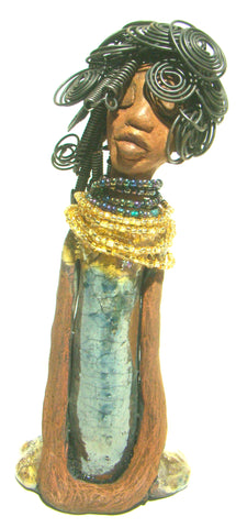 "Sophia stands 10.5"" x 4"" x 3"" and weighs 1.10 lbs. She has a  honey brown complexion with curls, coils and twisted, wire hair. Sophia wears a light blue crackle dress with a dazzling gold and multicolored beaded necklace."