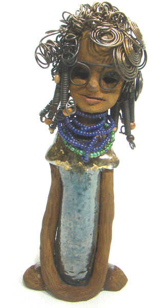 "Taylor stands 12'x 5""x 3"" and weighs 2.05 lbs. Taylor wears glasses and has a lovely honey brown complexion. She has over 20 feet of 16 gauge wire curls and coils. Taylor has a blue and gold dress with a purple and green  beaded necklace. Her long loving arms rest at her side. Taylor's big eyes underneath her glasses give her that sophisticated appeal. Let Taylor dignify a tapestry of beauty in your home. Free Shipping!"