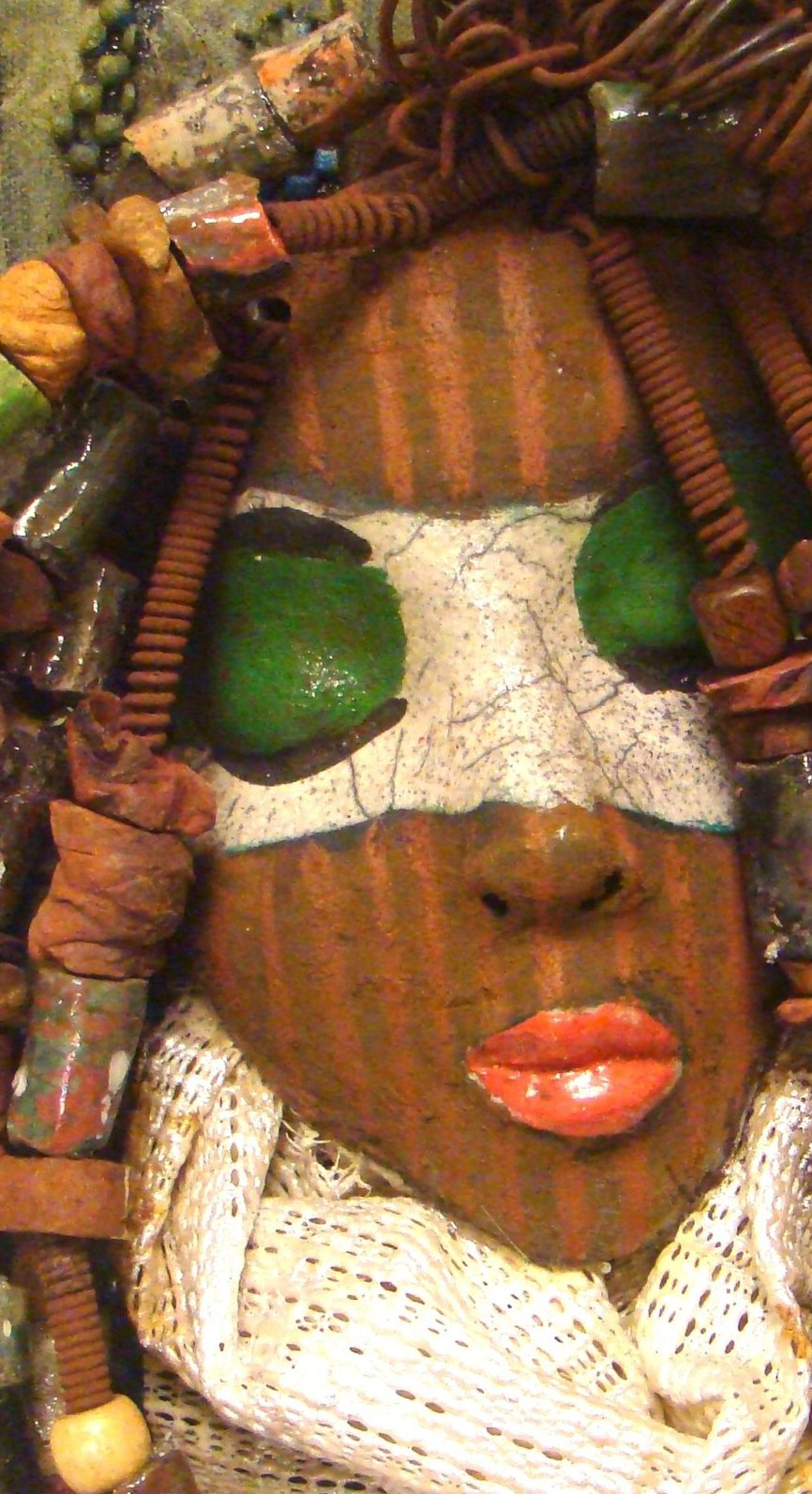 "Utah is mounted on a 8""x 10"" painted canvas. I spent about 4 hours or more just  fixing Utah's hair and attaching her beads! She has over 40 feet of 16 gauge wire for hair and over 50 raku beads. Utah has a white crackle face with green eyes, and ruby red lips. She is ready to be hung!  Free Shipping!"