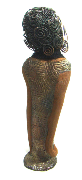 "Yvette stands 18"" x 5.5"" x 4.5"" and weighs 4lbs. She wears an etched textured copper dress with a black tulle scarf Yvette has a two tone honey brown complexion. She has over 20 feet of spiral wire hair. Yvette has her long loving arms at her sides. Her face and demeanor says it all. Free Shipping!"