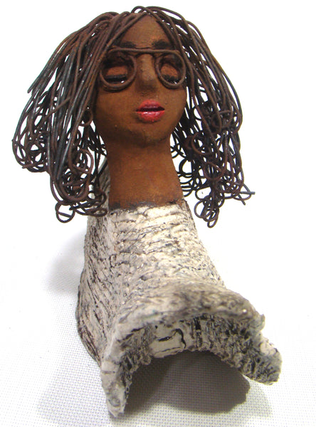 "Adia stands 8"" x 9"" x 4 and weighs 2.11 lbs.     Adia has a nice honey brown complexion and wears glasses.     She has over 8 feet of 16 gauge wire hair.     Adia wears a textured white crackle robe.     She is angelic!  Adia will make a great gift or starter piece from the Herdew Collection Free Shipping!"
