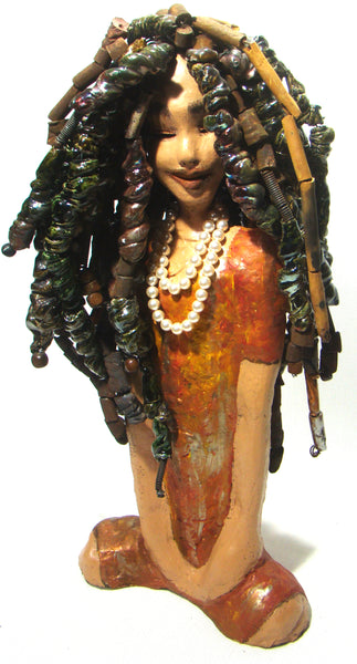 "Bee stands 23"" x 10"" x 6"" and weighs 17lbs.     She wears a string  of Swarovski crystal creamrose  pearls around her neck.     Bee' dress is yellow orange with flashes of metallic gold and silver.     She has over 100 hand rolled raku beads in her hair.     Bee would be a great show and conversation piece in your home.      Free Shipping!"