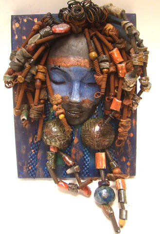 "I started making mask after seeing an authentic African Mask collection at the Smithsonian Museum of African Art. I was in total awe.  Blu was inspired by my visit there. Blu is mounted on a 9""x 12"" painted canvas. I spent about 4 hours or more just  fixing Blu's hair and attaching beads!      Blu has over 40 feet of 16 gauge wire for hair and over 50 raku beads.     Blu has a blue and brown crackle face with rust brown  lips.     Blu is ready to be hung!    Free Shipping!"