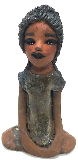 "Meet Brenda!      Brenda stands &' x 4"" x 2.5"" and weighs 11 ozs.     She has a lovely honey brown complexion.     Brenda wears a metallic green dress.     Her hair is smokey black.and made of clay.     Brends's long loving arms rest at her side.  Brenda will make a great gift or a starter piece from the Herdew Collection!"