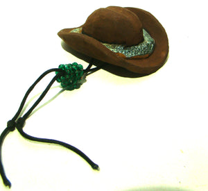 "This hat is 1"" x 4"" x5"" and weights 9.7 ozs.     It is solid rust brown with a light green band green.     Green hand beaded drawstring     Good sit around conversation piece."