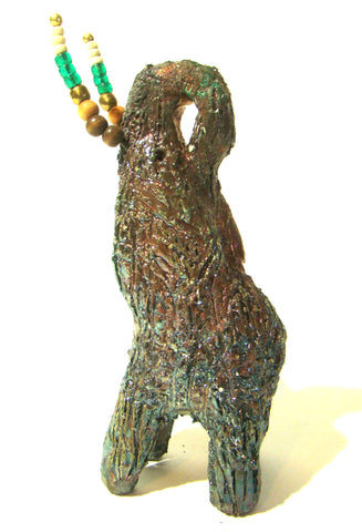 "This raku fired elephant stands 7"" x 2"" x 2.5"" and weighs 10 ounces. She has beaded tusks and a textured copper body. Nice!"