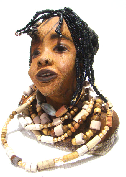 "Eve is 9"" x 9"" x 5"" and weighs 5.06  lbs She has a lovely honey brown complexion Eve wears several stands of homemade raku beads. Her top has a pattern that is etched within a white crackle glaze. Eve has smokey black clay hair with black pony beaded locs and bangs. She is quite irresistible. Free Shipping!"