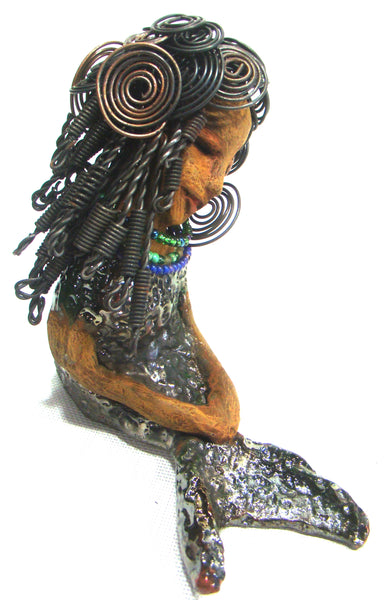 "Harmony sits 7"" x 3"" x  7"" and weighs 1.14 lbs.         She has over 40 feet of 16 gauge wire hair.         Harmony complexion is cocoa brown.         Her swimsuit  are a  textured metallic alligator green.         Harmony is one who brings happiness!      Free Shipping!"