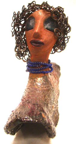 "Helen stands 8"" x  8"" x 3"" and weighs 2.06 lbs. She has a lovely honey brown complexion. Helen has a metallic copper glaze on her textured robe. Her blue eye shadow matches the blue strand of beads around her neck. Helen has over 20 feet of curly wire hair. Helen is somewhat angelic! Give Helen a prominent place in your home!"