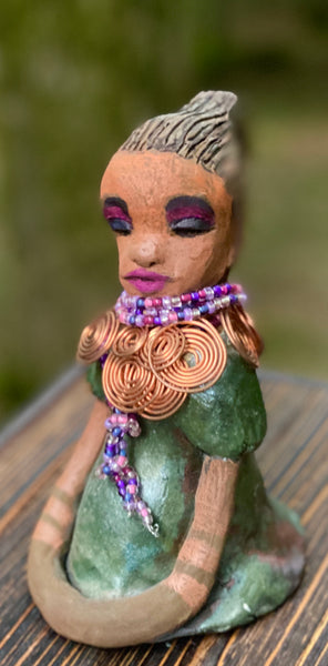 """Honestly, I can not explain where this desire to make Charlotte  comes from. When I created my first raku fired sculpture , I was amazed at how well my homemade metallic copper green glaze worked with the  body. It was a good match with the honey brown complexion and the colorful eye shadows I am beginning to use with  my new sculptures."