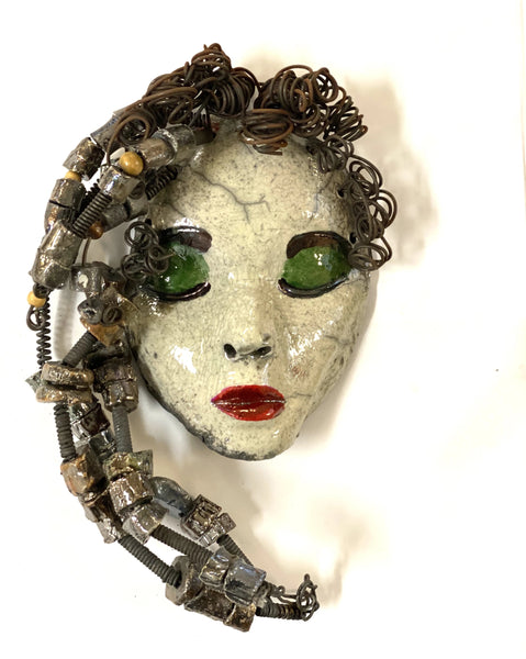 "Mckenzie has a white complexion, green eye shadow, and ruby red lips! She is 7""x 5"""" and weighs 1.8 lbs. Mckenzie  has over 20 handmade raku fired beads. She has over 20 feet of coiled 16 gauge wire hair."