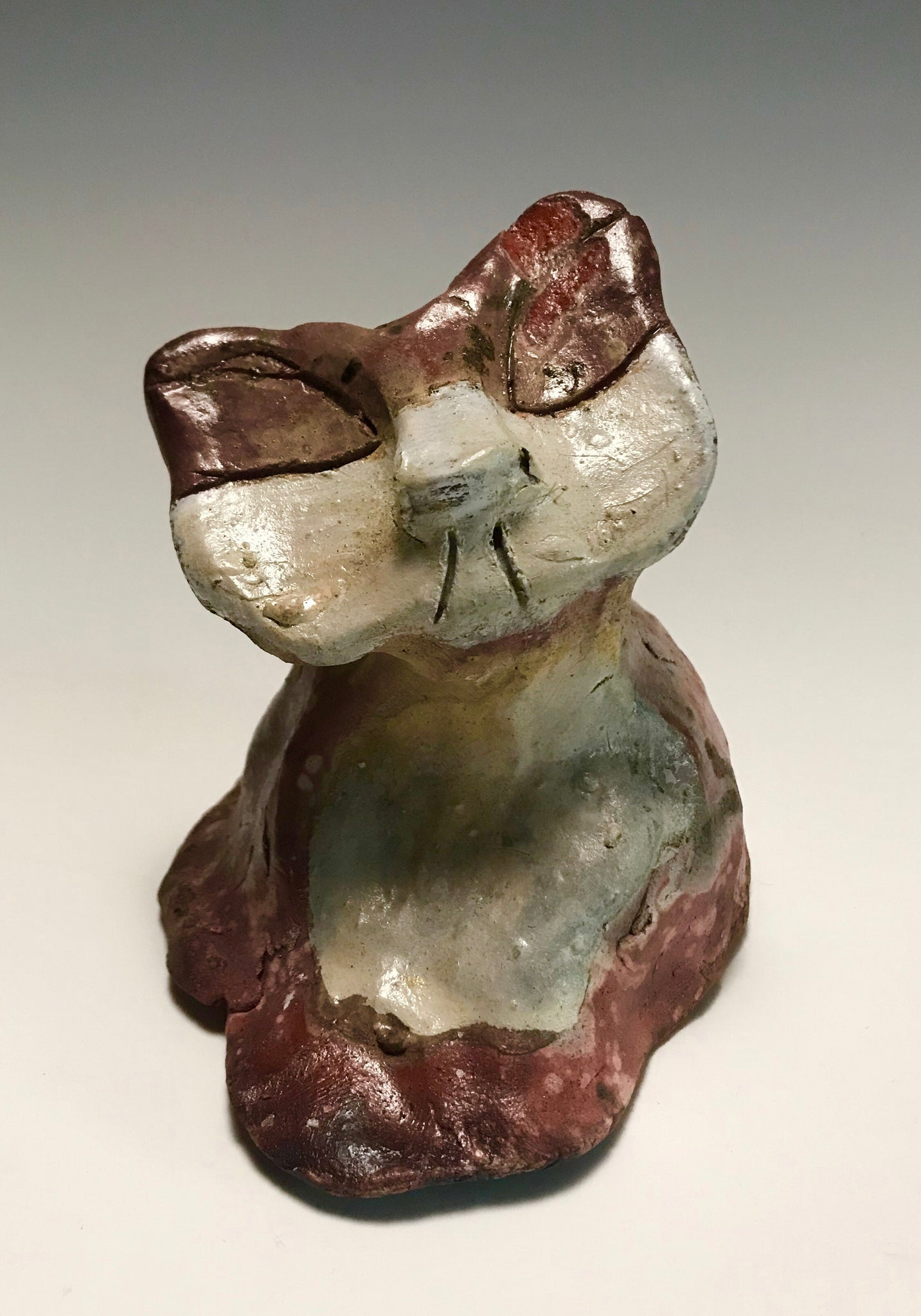 "This little kitty stands 4"" x 4"" x 4"" and weighs 9 ozs. He has an off white and Colorful metallic  pinkish body. This little kitty will sit anywhere without getting into trouble! This Little Kitty could be an excellent gift and stocking stuffier."