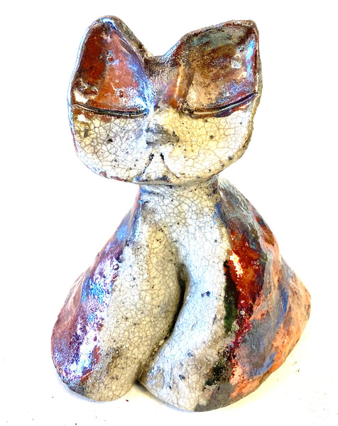 "Eva sits 5"" x 4"" x 4"" Black, white, and copper textured body Weighs 9.4 ozs Must have!"